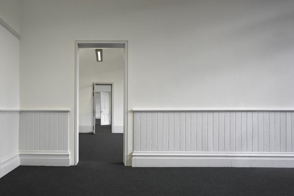 Kings Cross Redevelopment, London. Empty White Room with White Wainscotting Panels