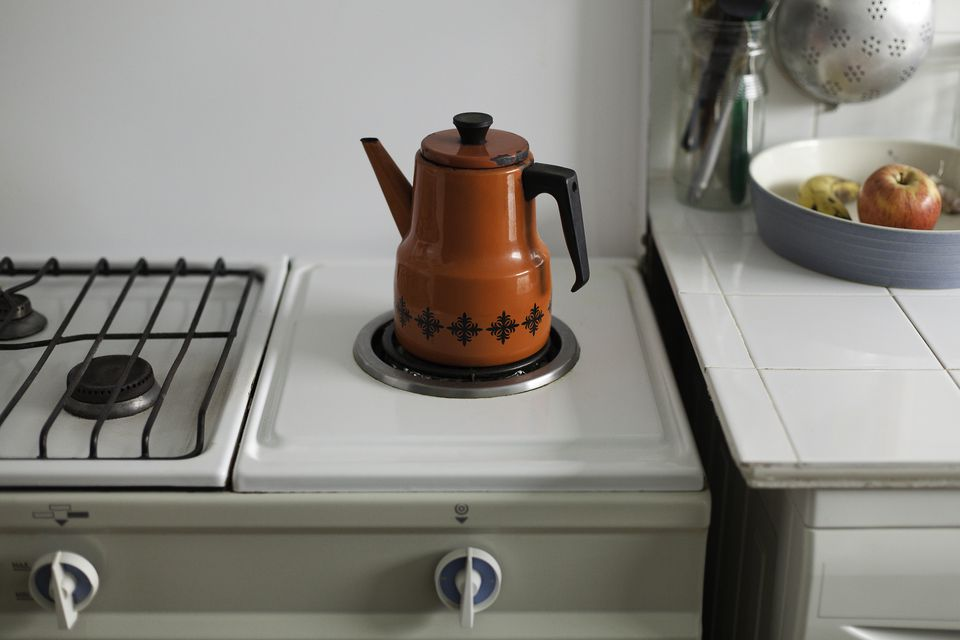 Red coffee pot and fruit