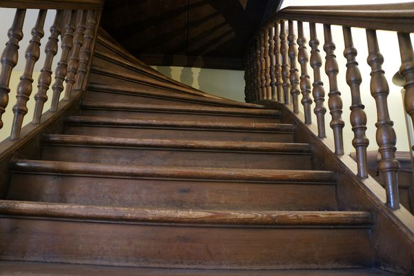 A staircase viewed from the base of the bottom