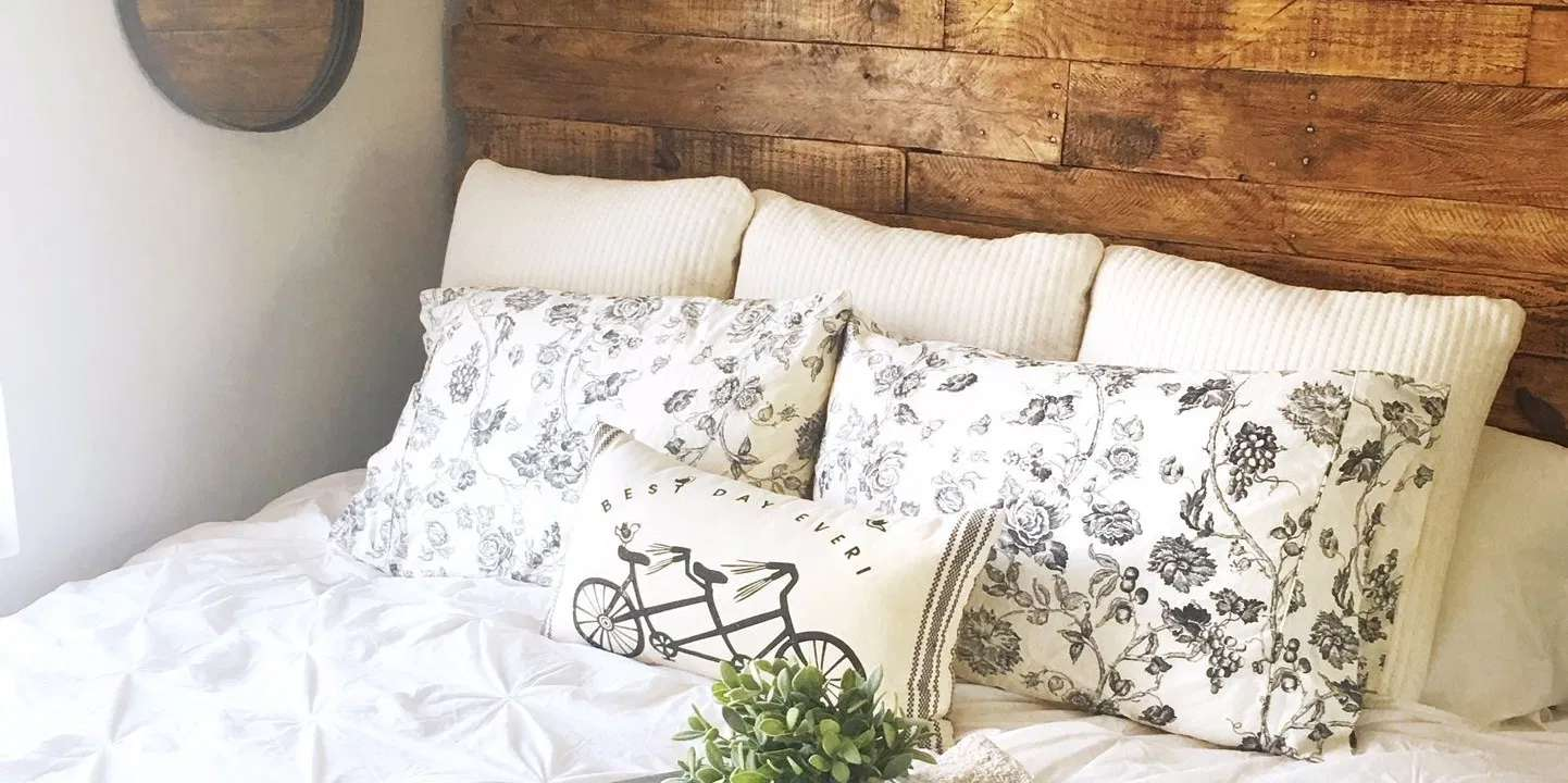 A close-up of a bed with a pallet headboard