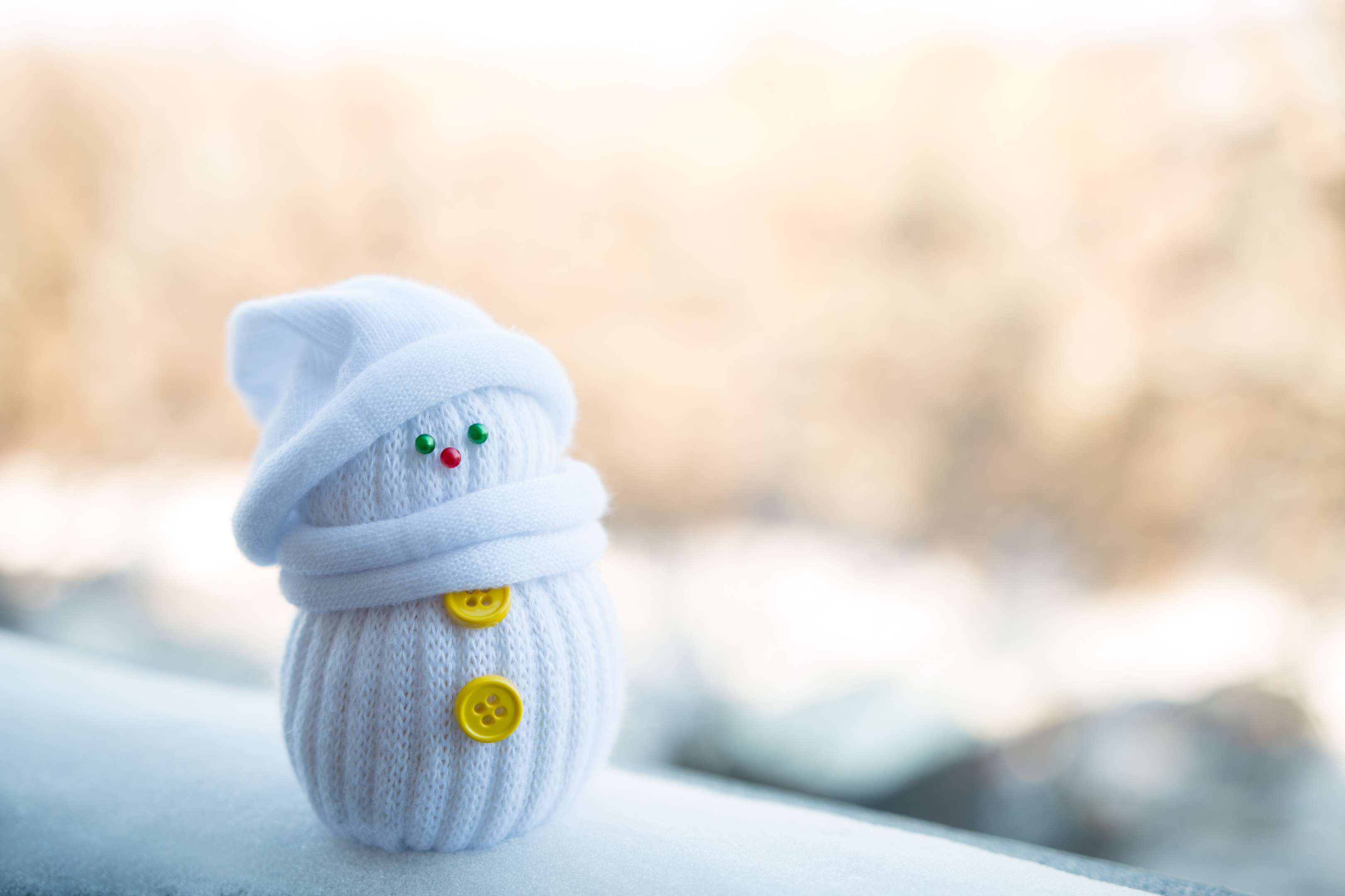 Cute little snowman on a blurry background