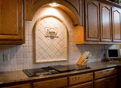 Kitchen backsplash with tile medallion over stove