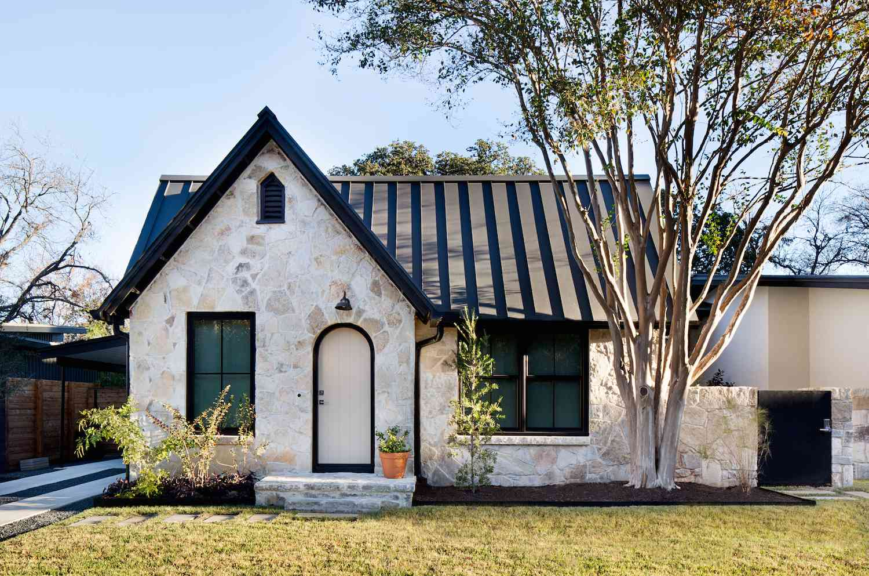 english cottage with wood paneled roof