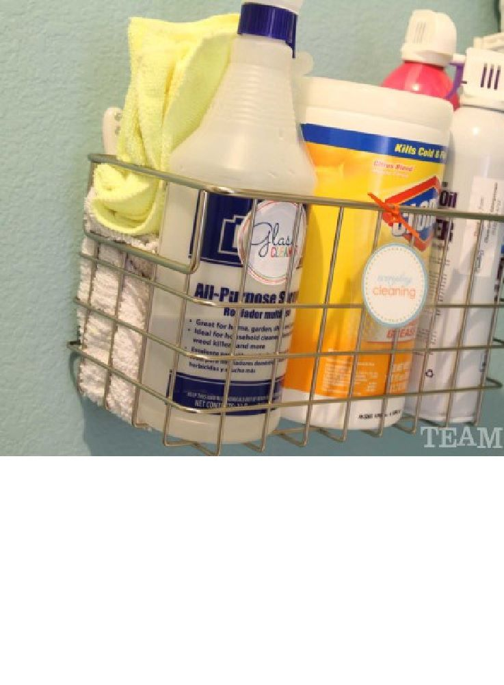 Laundry supply organization, including wipes and cleaner in a wall-mounted shelving unit.