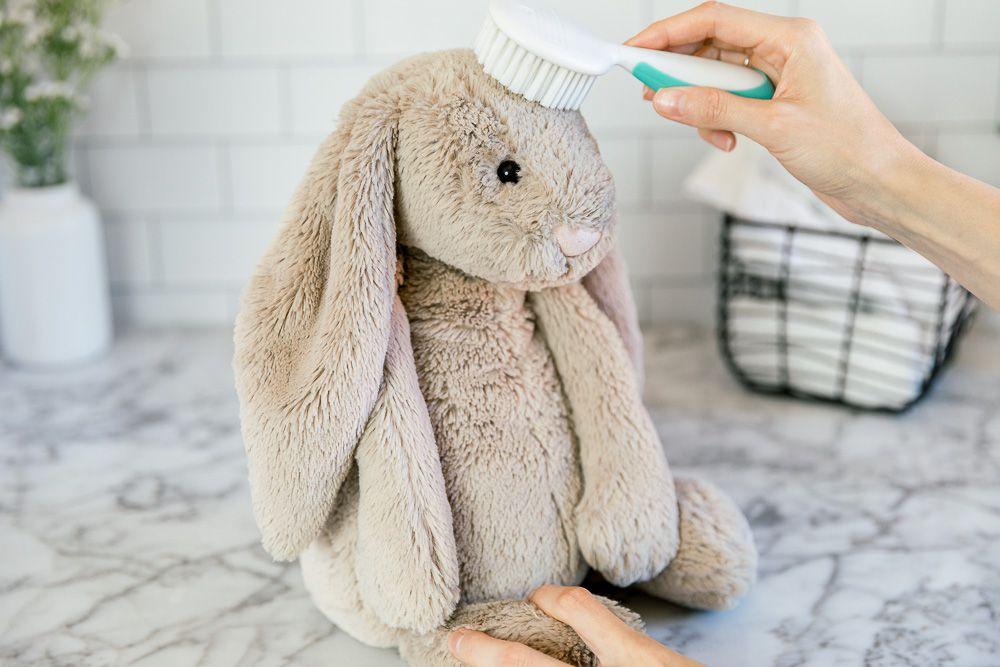 grooming the stuffed animal
