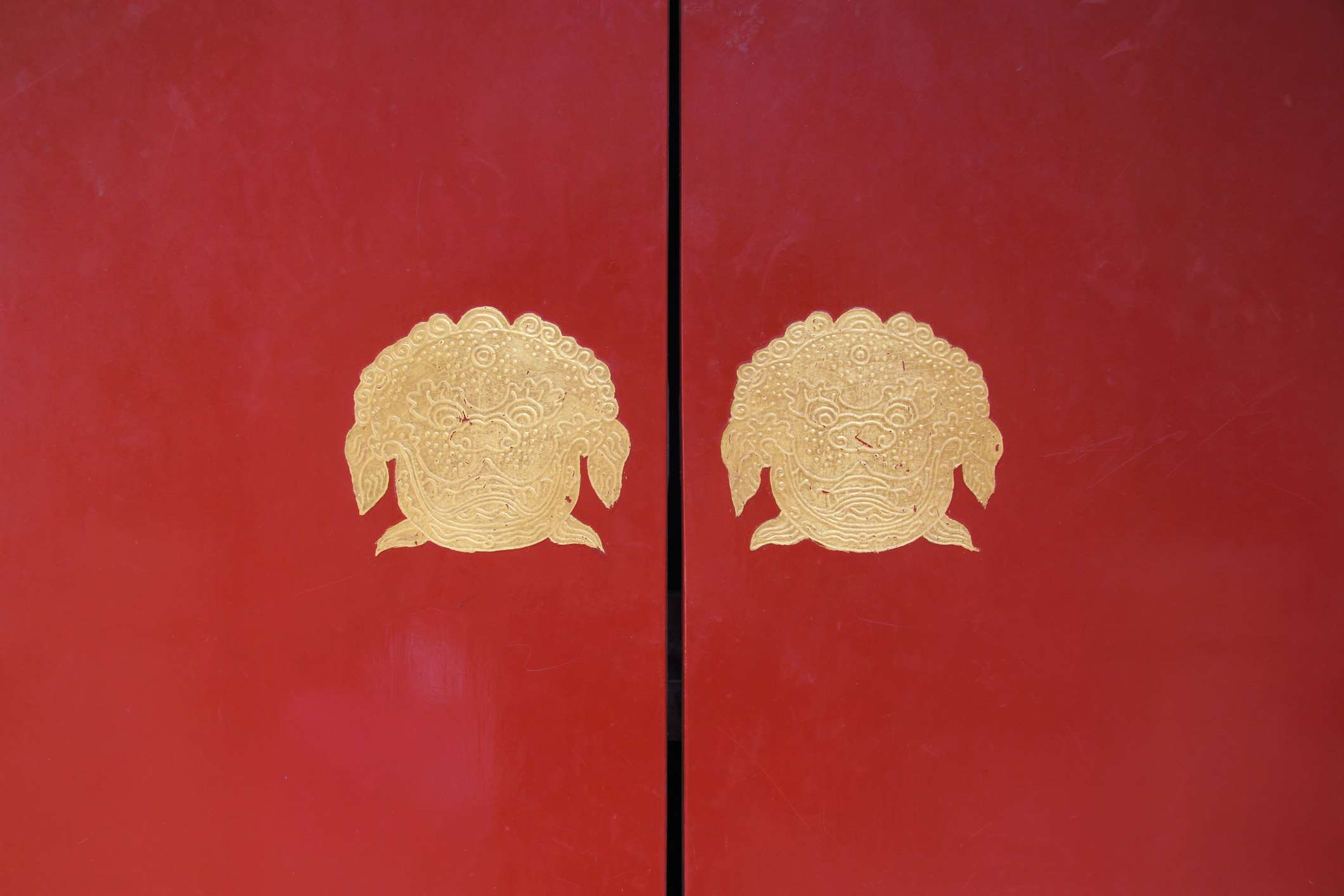 Beautiful Chinese doors in red with images of fu dogs