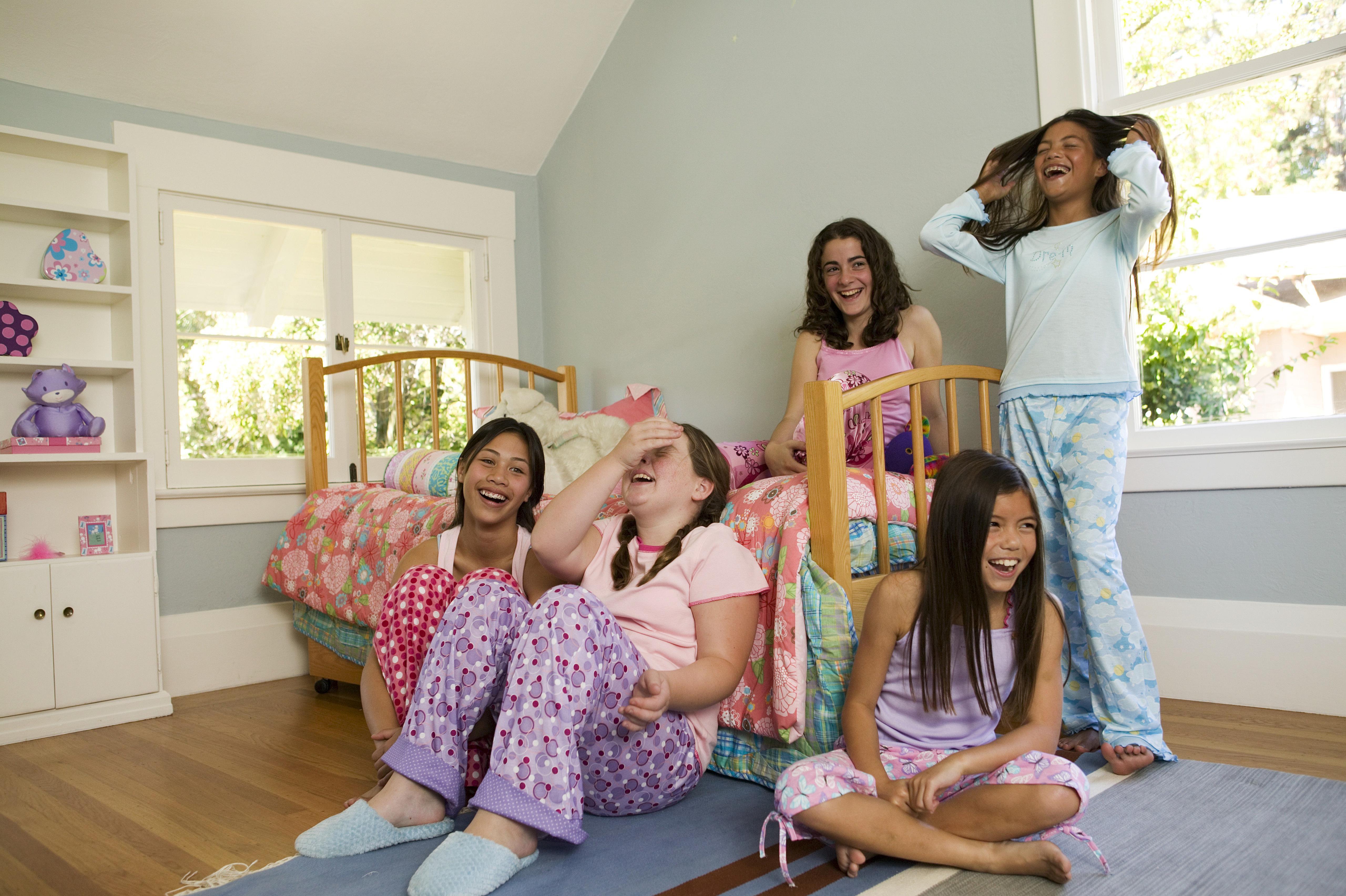 d887c19c06 Five girls (9-11) wearing pajamas in bedroom
