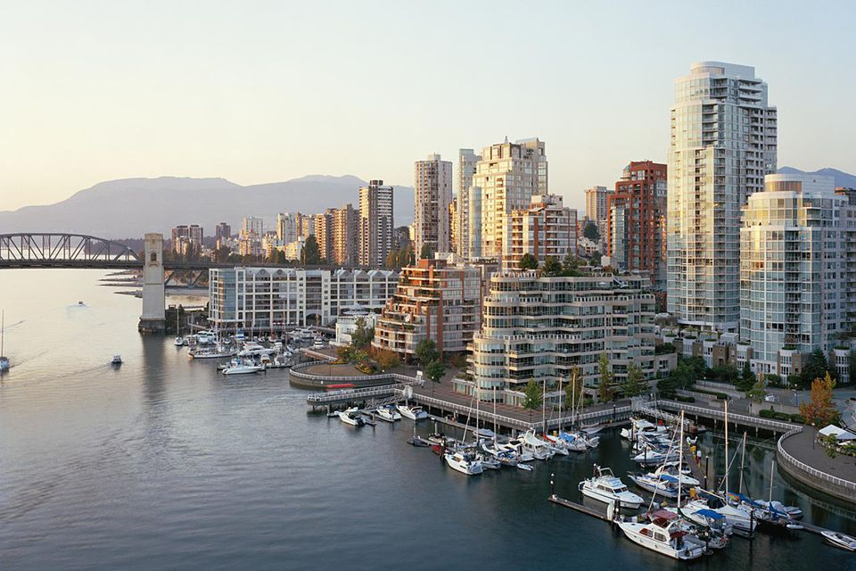 Canada, British Columbia, Vancouver, yachts moored in marina, city skyline in background
