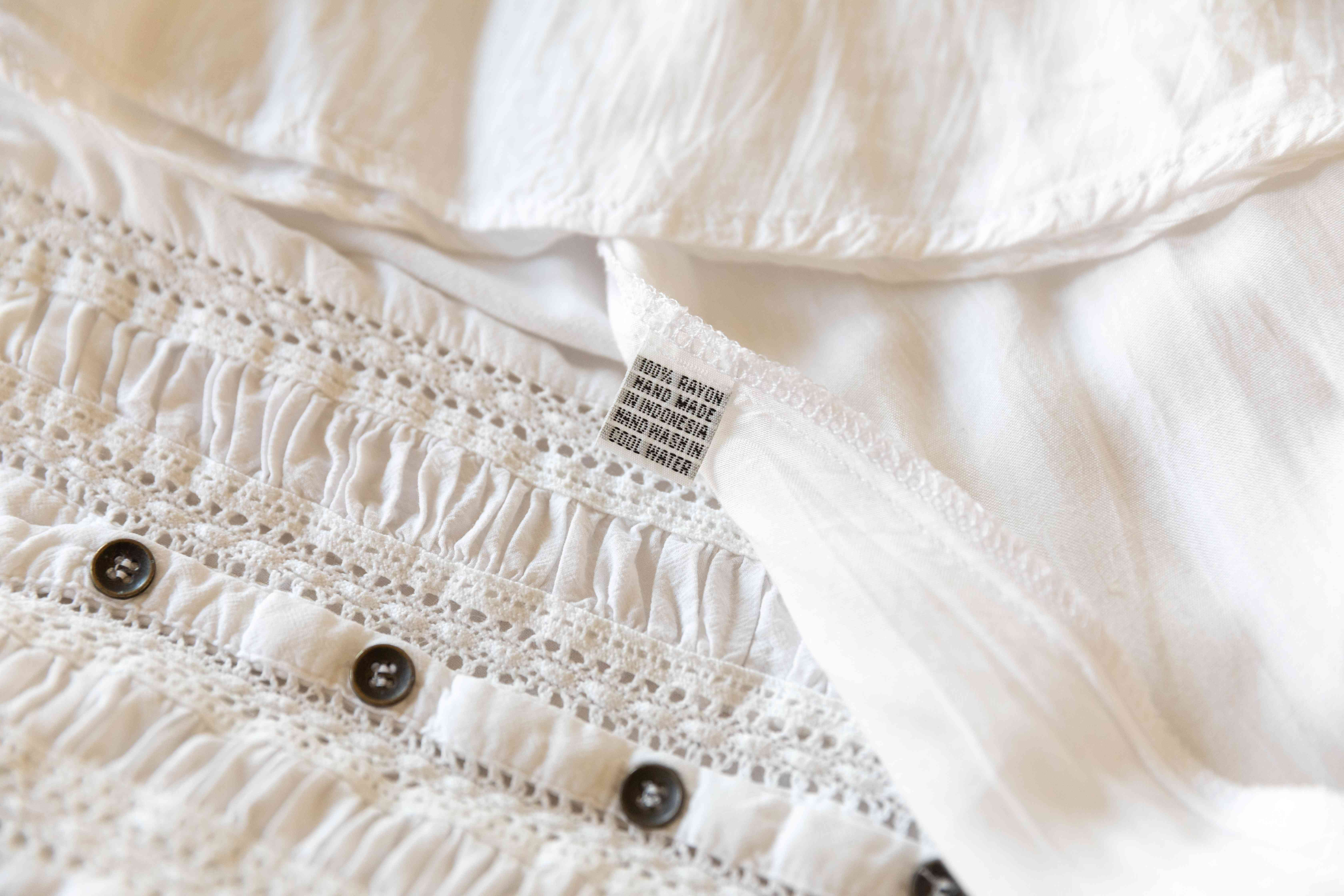 The care tag on a white rayon top