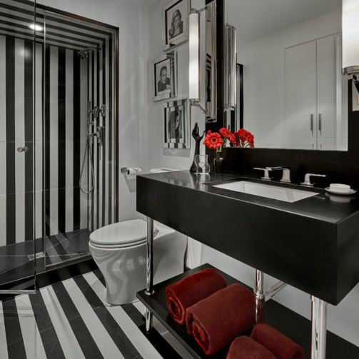 Striped black and white bathroom with red accents