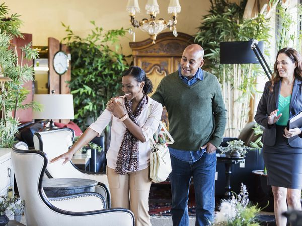 African American couple shopping in furniture store