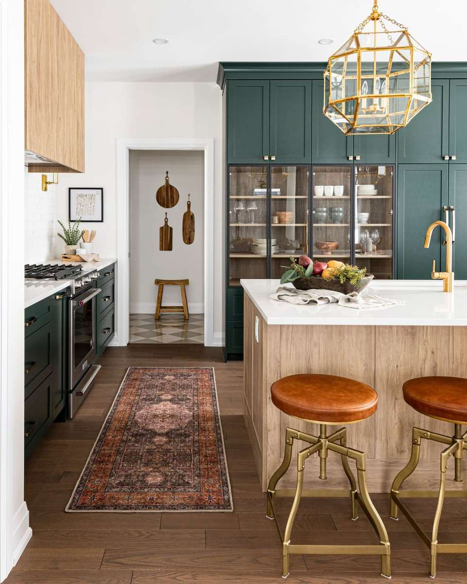 Green kitchen with bar stools