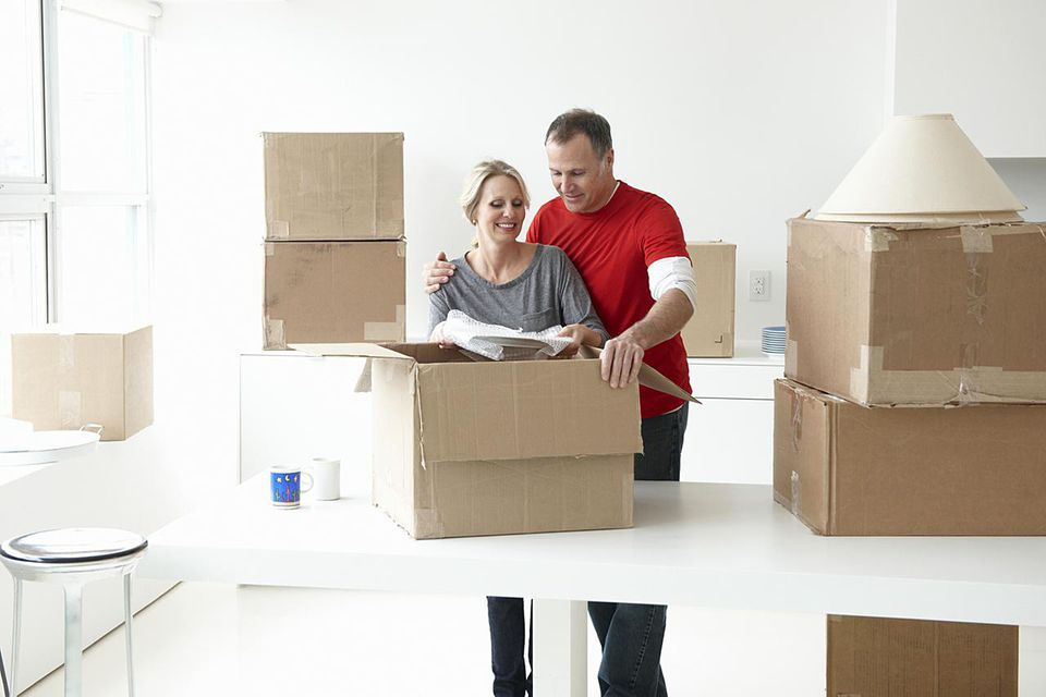 older couple unpacking boxes in their new home