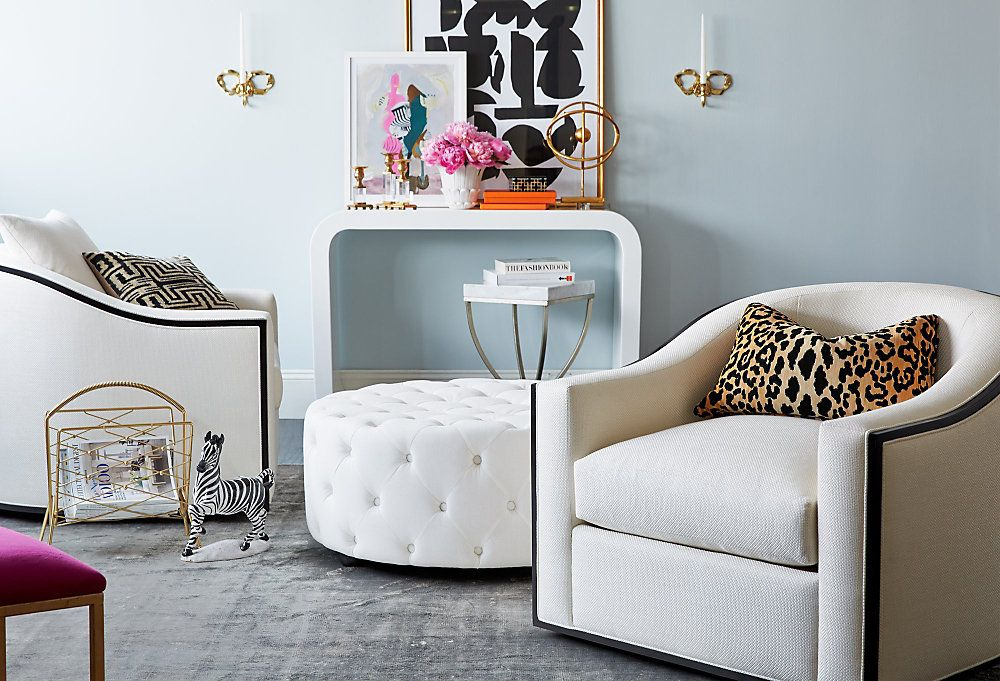 White chairs with patterned pillows in a blue room