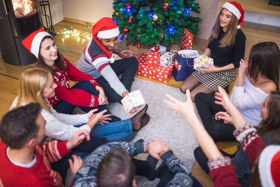 Friends giving each other Christmas gifts