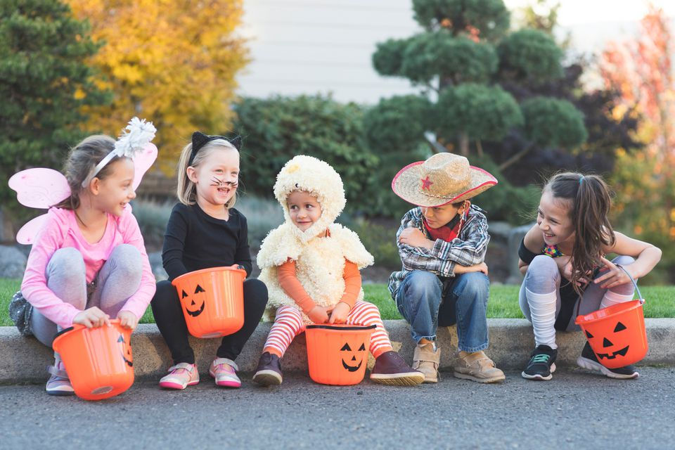 Multiethnic group of kids trick or treating