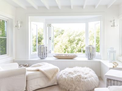 comfortable white living room with large window