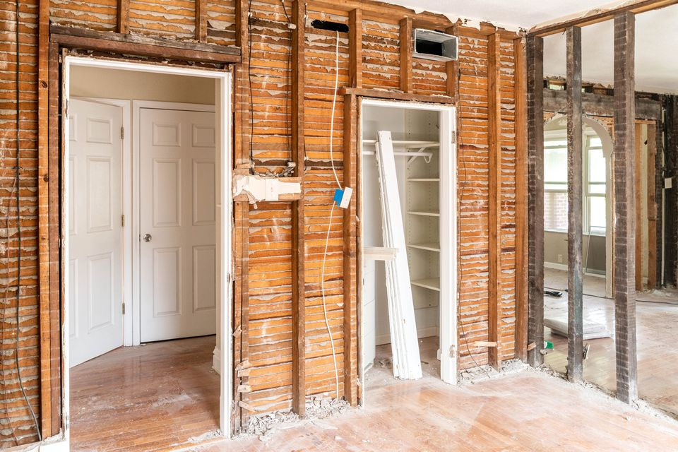 Home interior being rebuilt with exposed wood structure beams
