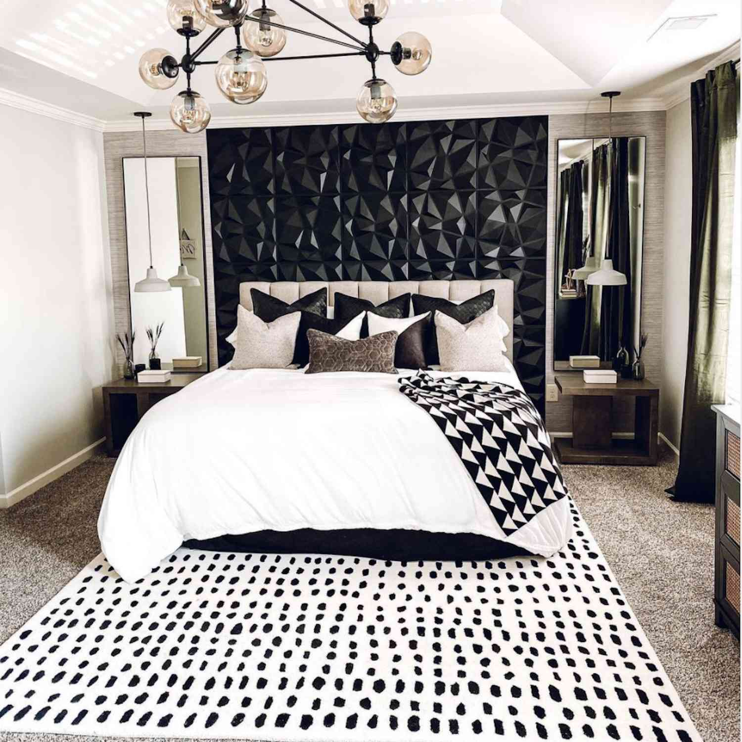 black and white modern bedroom with black geometric textured accent wall