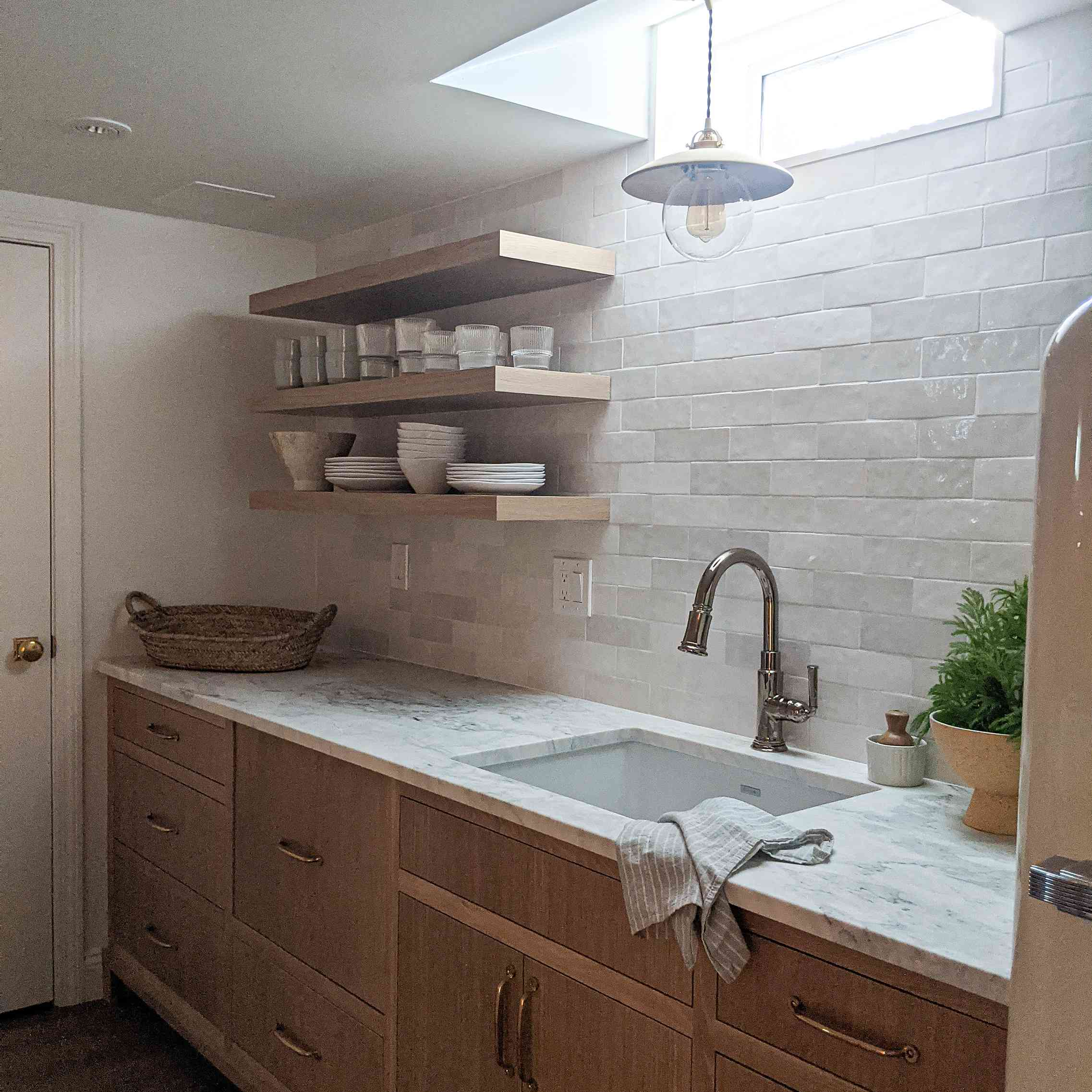kitchen has a skylight over the sink and open shelving