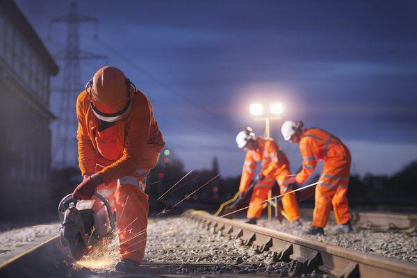 workers using power grinders