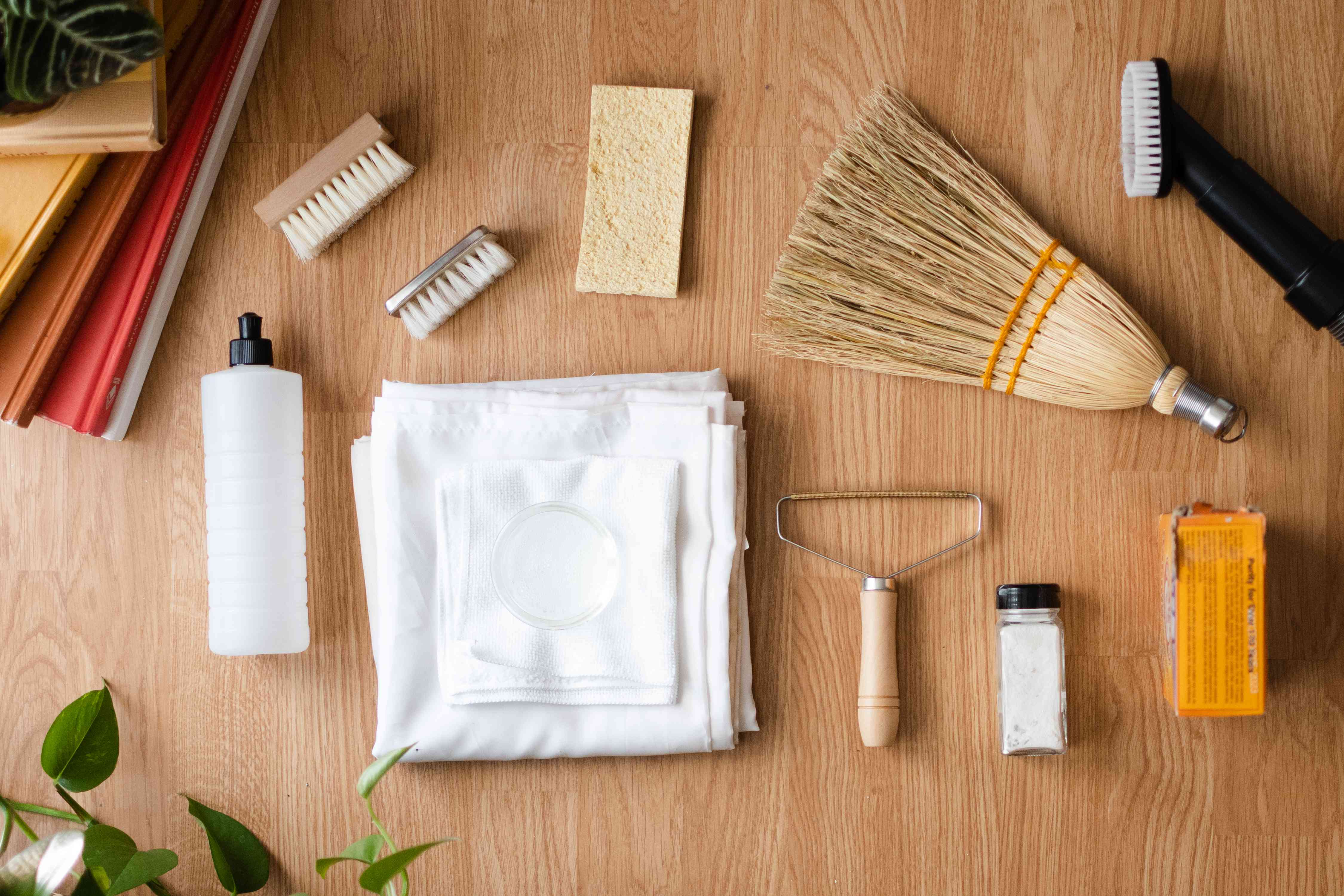 Materials and tools to clean a shag rug on wooden surface