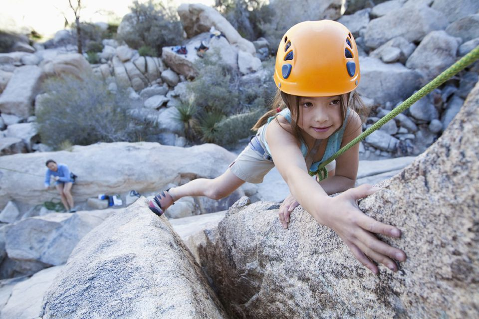 A picture of a girl rock climbing
