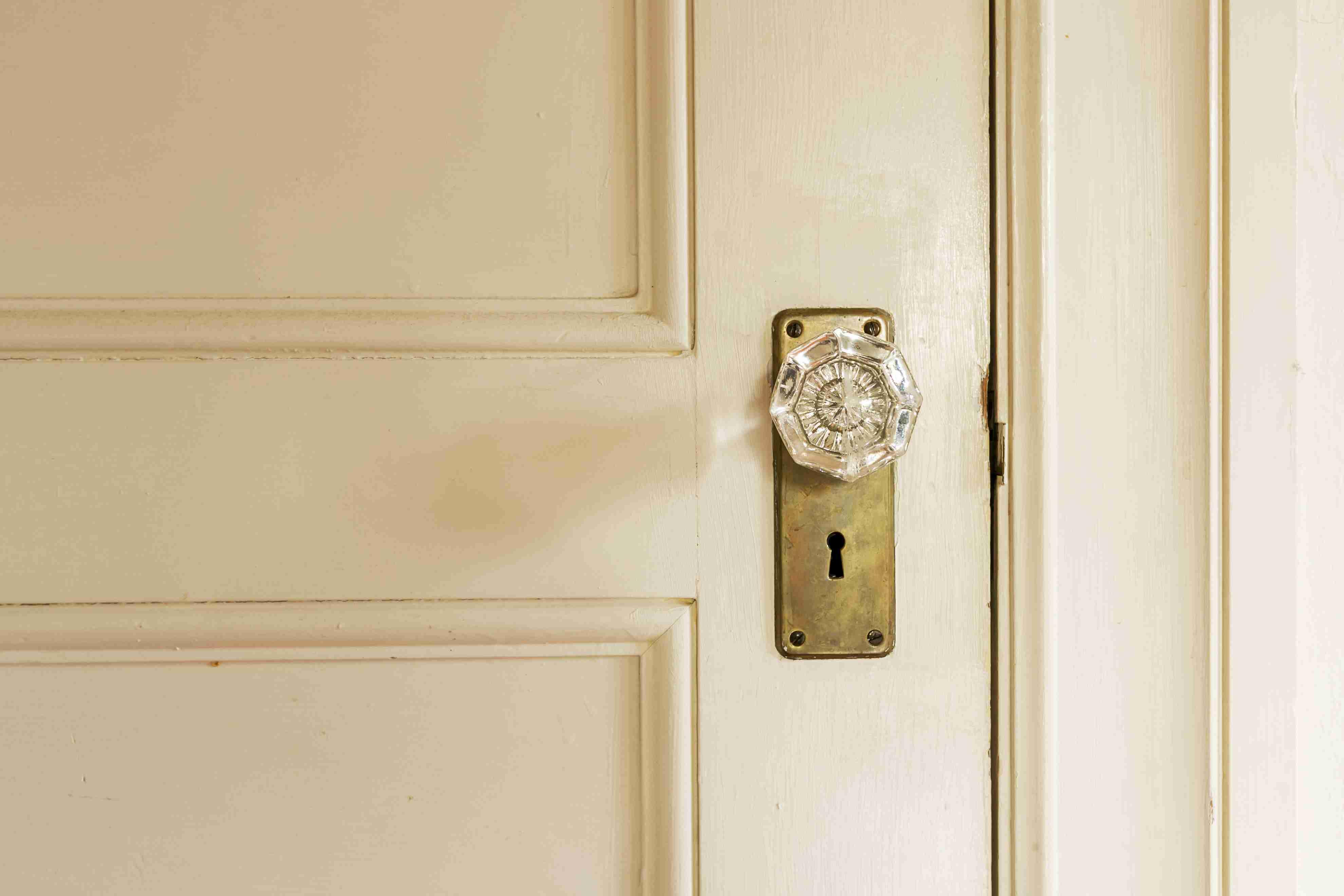 crystal door knob on a cream-colored door