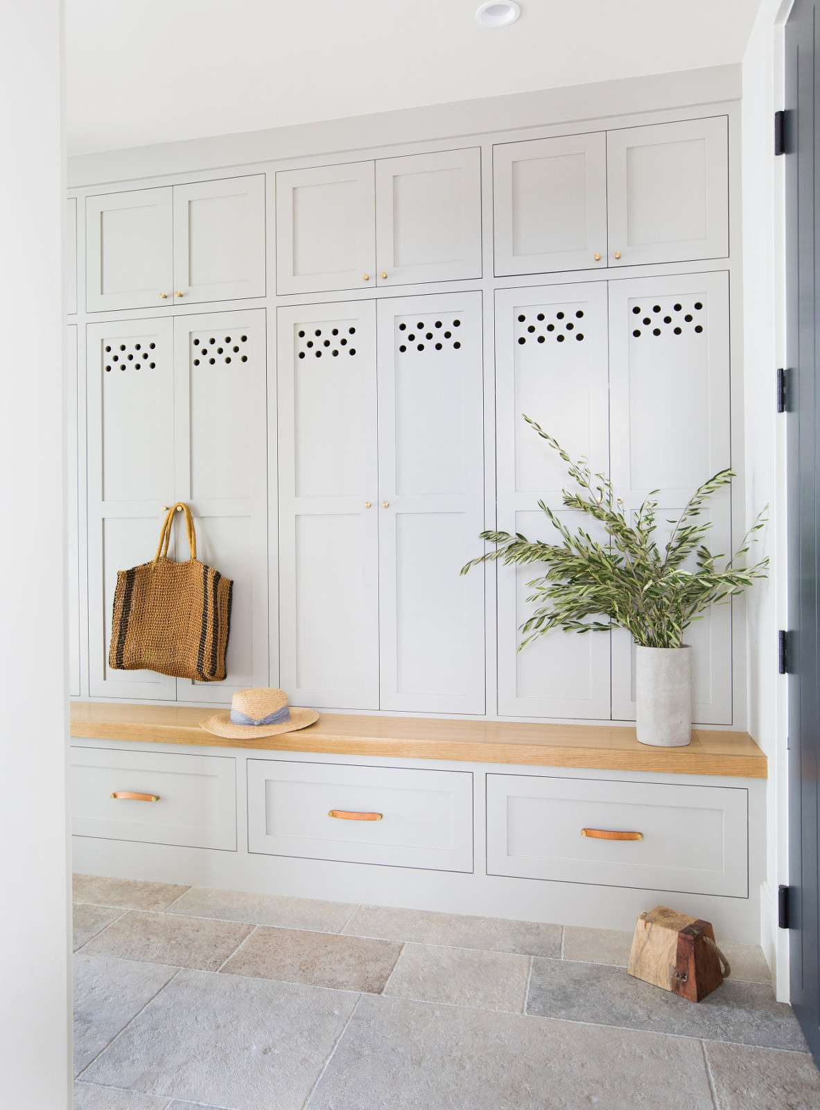 Dove gray built-in mudroom bench with storage lockers