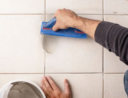 Use a grout float to fill grout joints