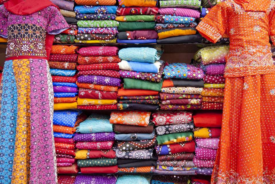 Kurti and Saris Stacked for Sale
