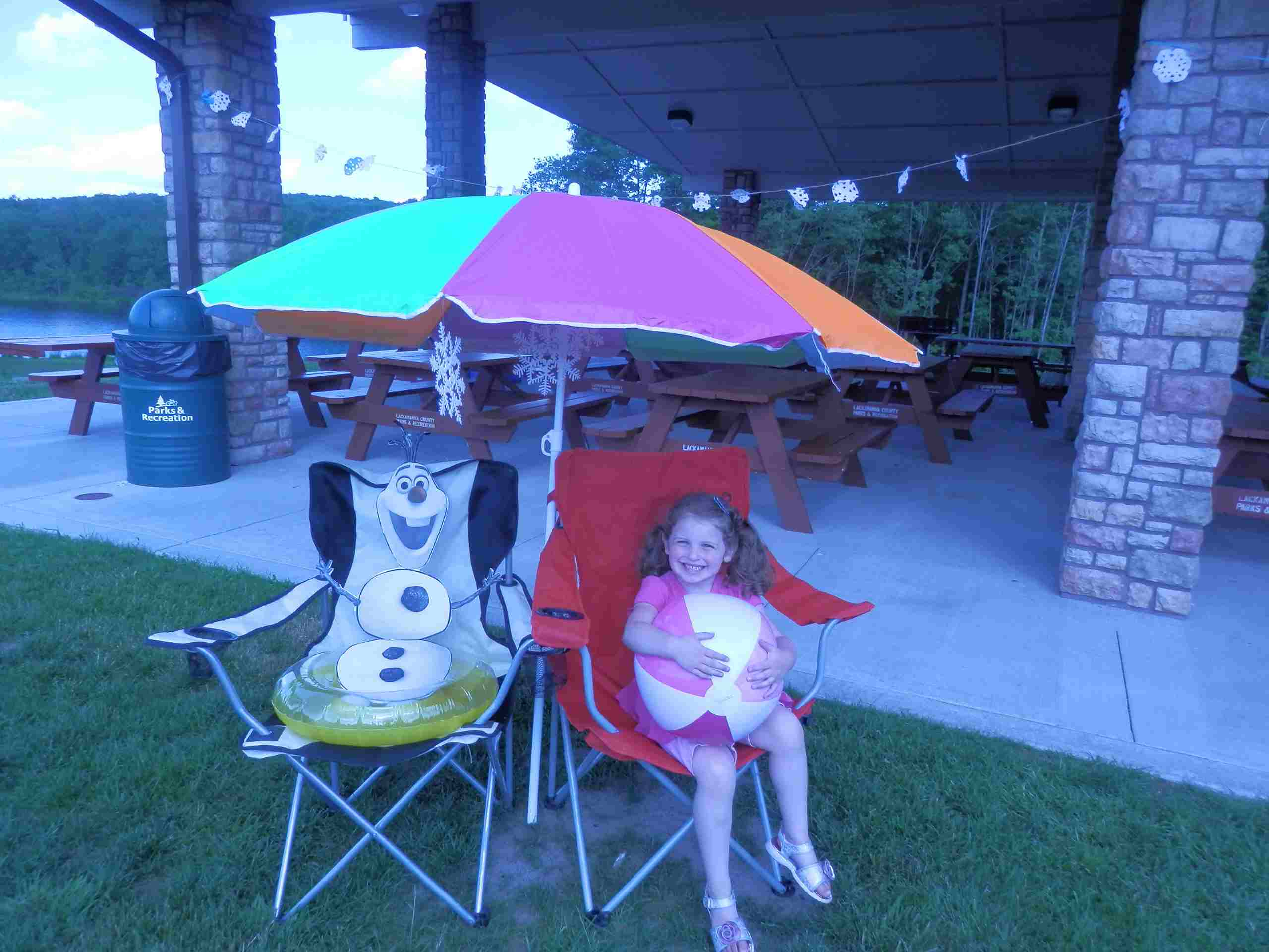 Frozen beach chairs and umbrella
