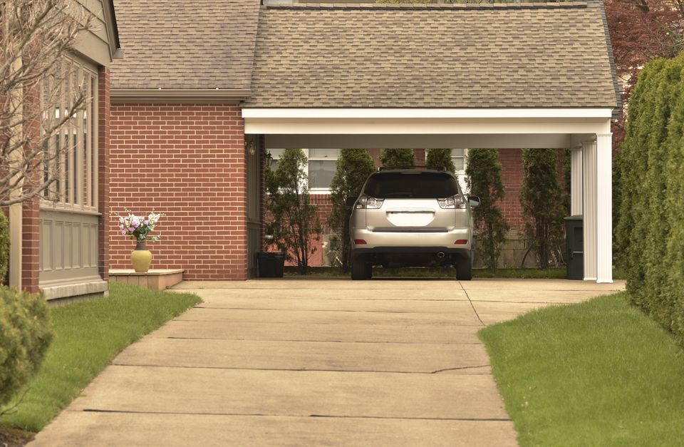 Carport with parked car and Nicely Maintained Grounds