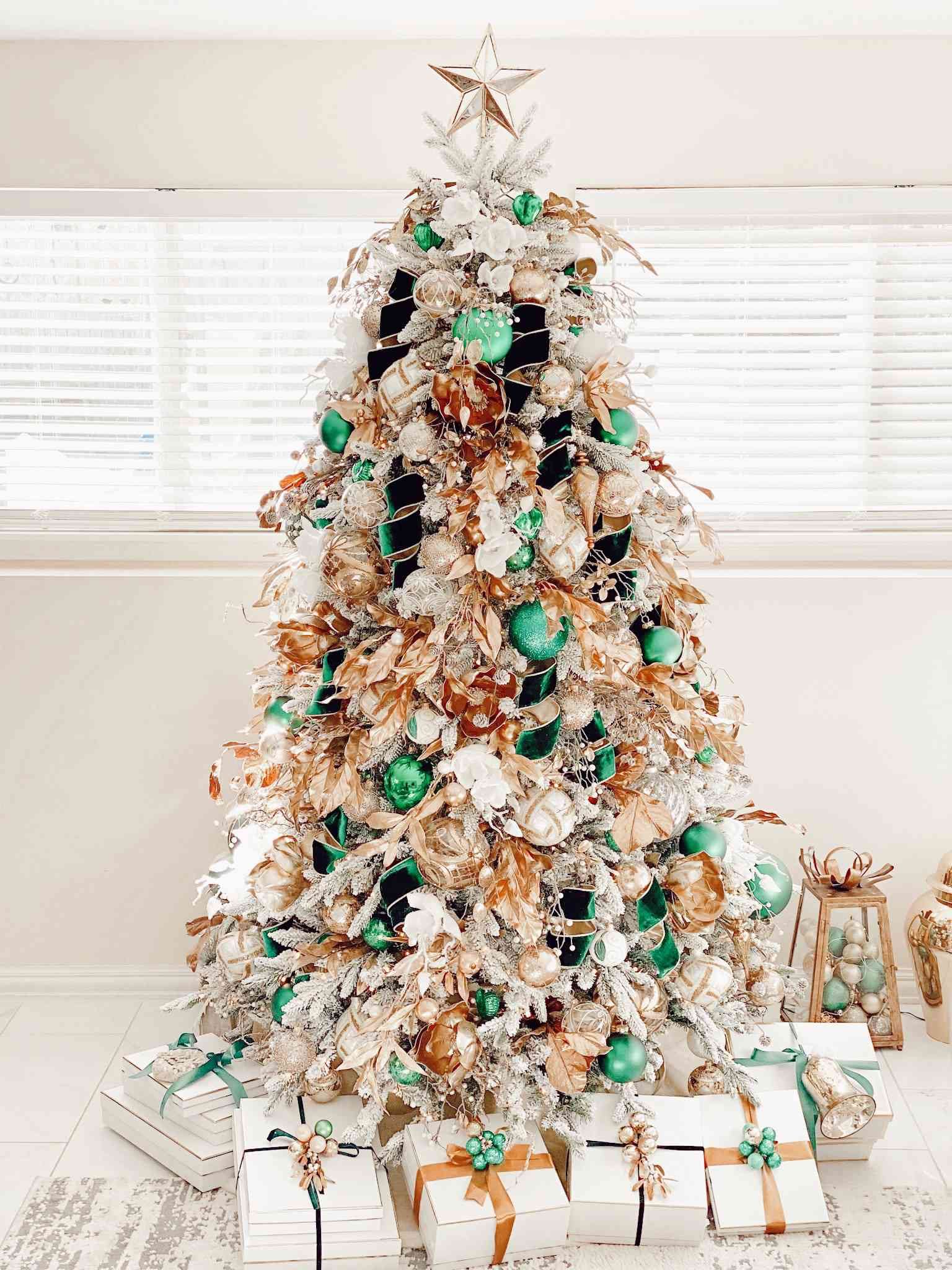 Maricela Caballero's white Christmas tree with emerald green and gold ornaments