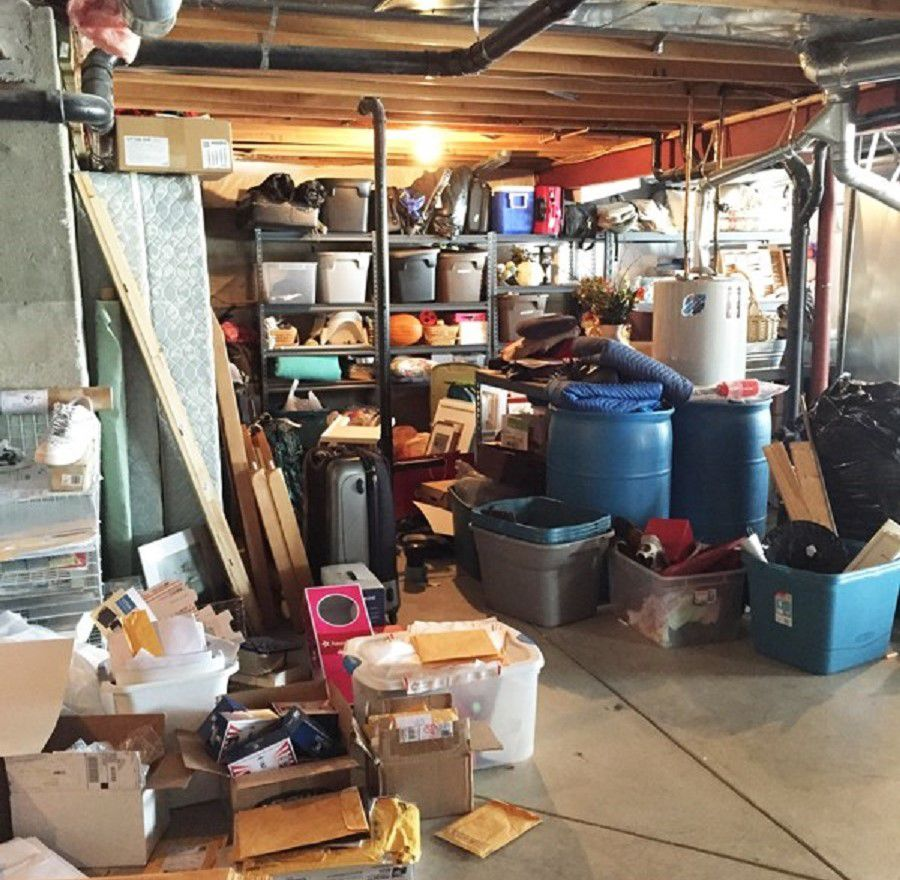 Cluttered Basement Before Remodeling