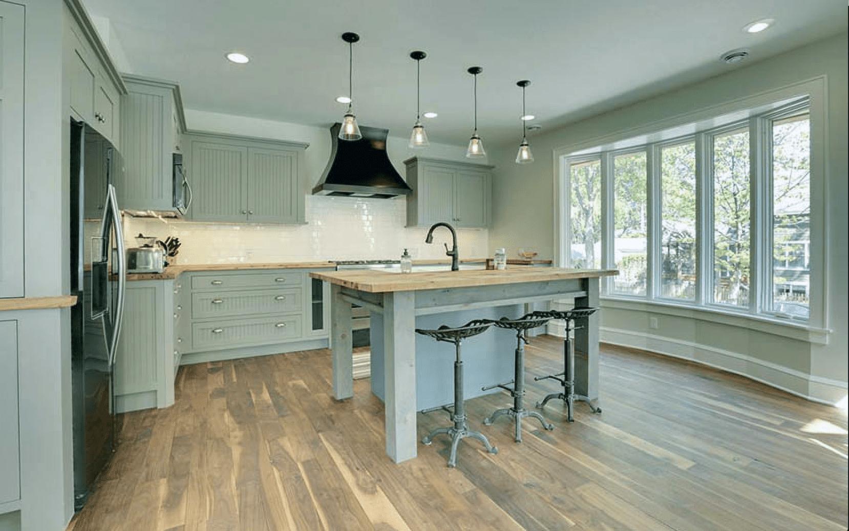 sage kitchen with butcher block countertops
