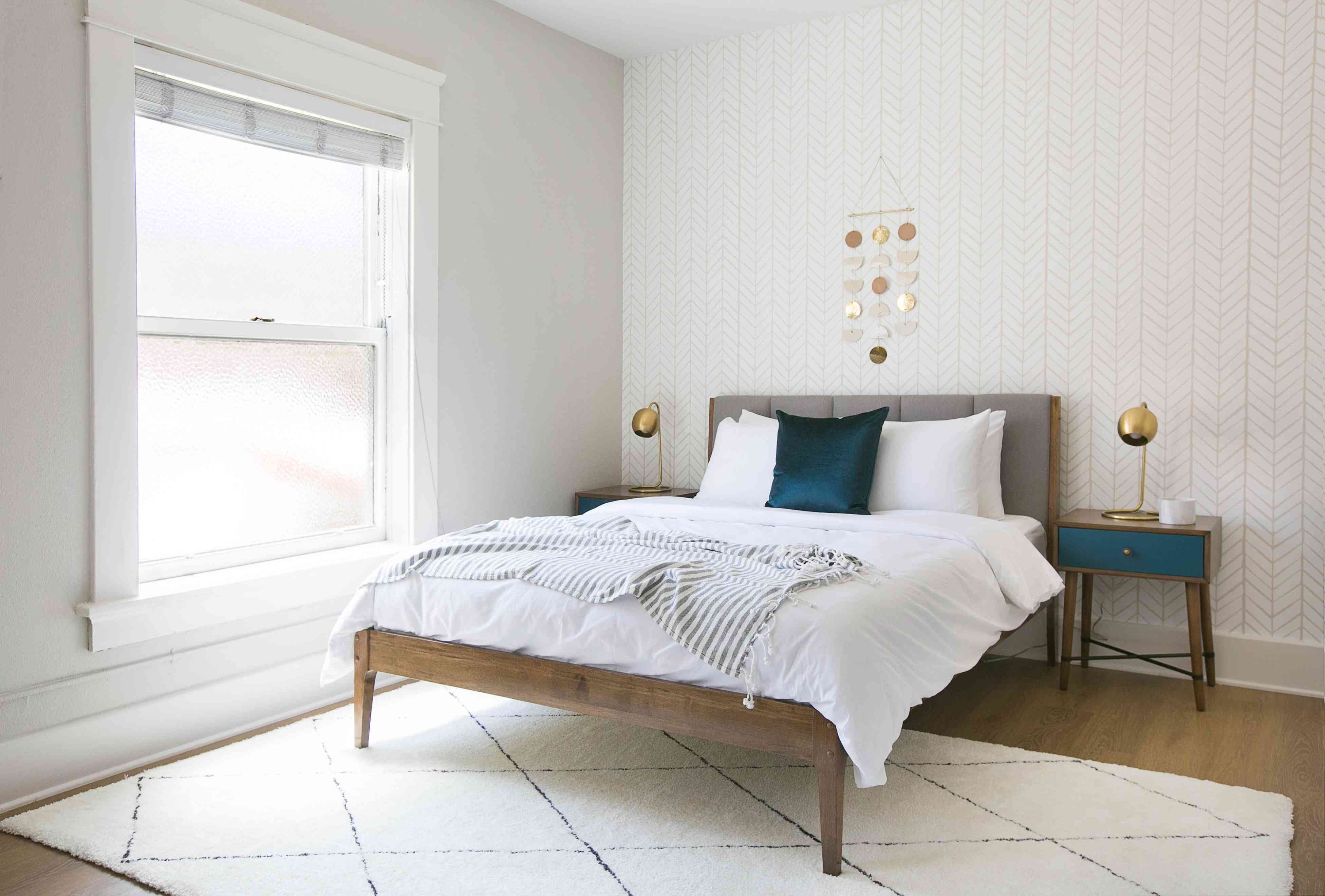 Gray and white bedroom with an aqua pop of color. Bedroom follows the 60-30-10 color rule