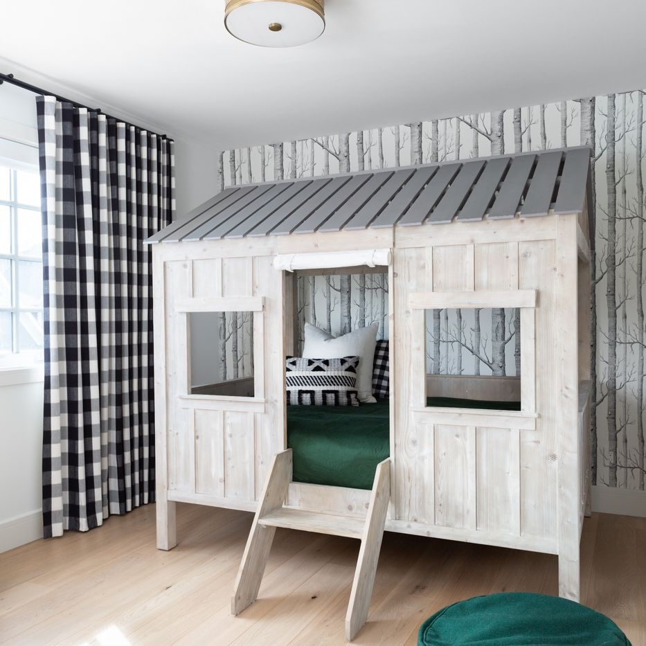 Loft bed in forest themed bedroom