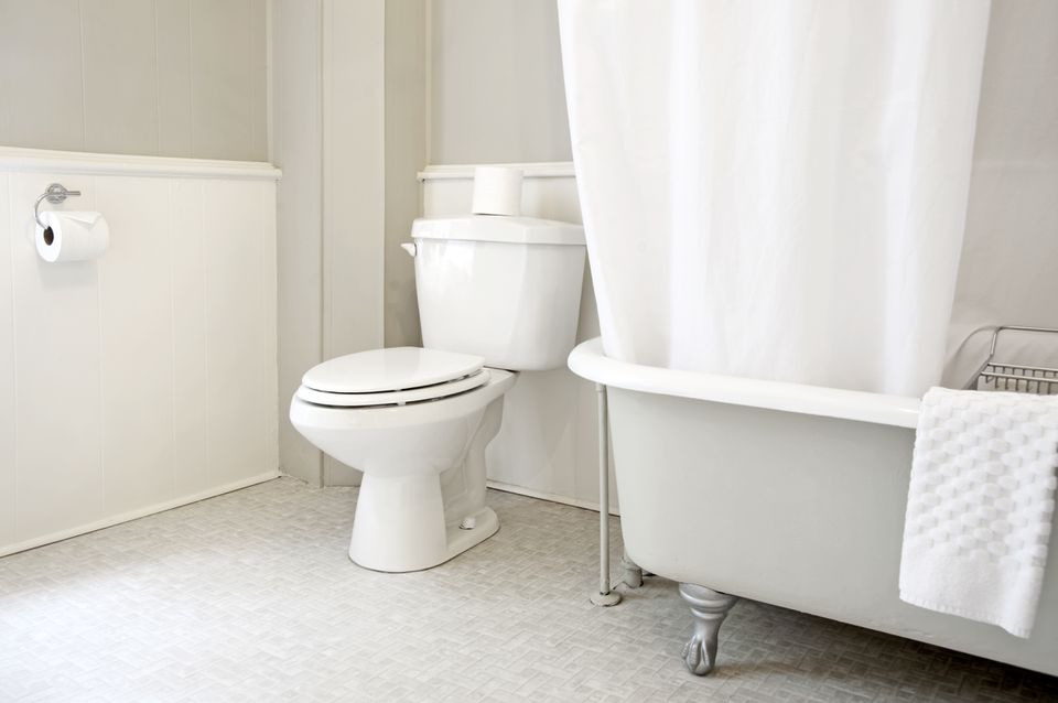 A stark bathroom interior with a simple toilet