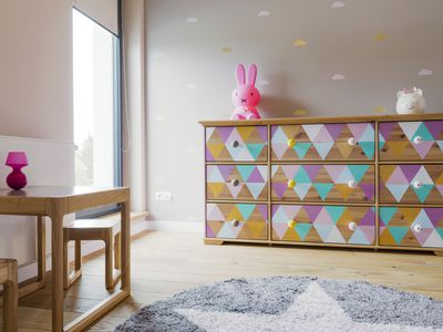 Delicacy of little girl's pastel-coloured room