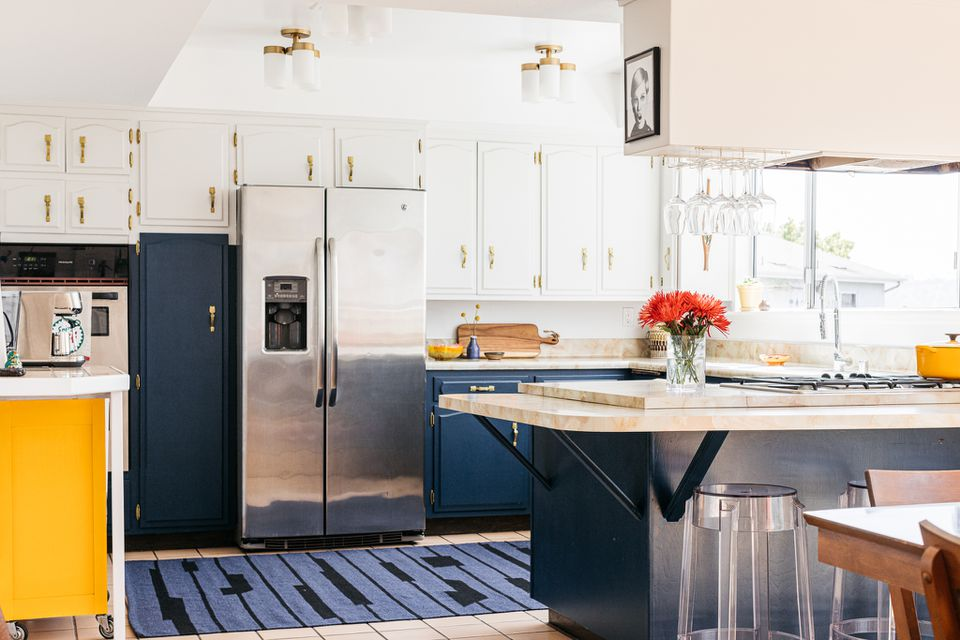Brightly-lit kitchen with blue and white painted cabinets