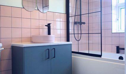 Bathroom with pink tile and black vanity