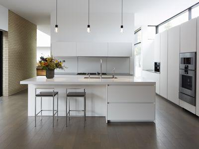White and sleek large modern kitchen