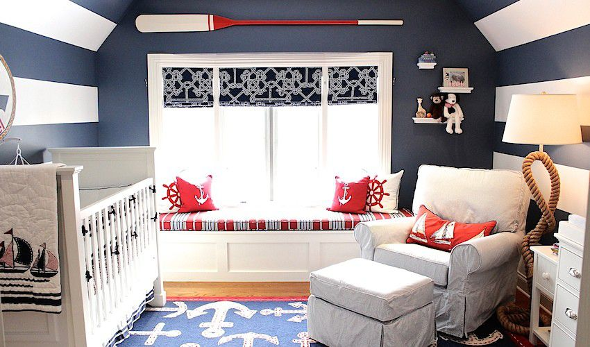 Red, white, and blue nautical nursery with striped walls and ceiling.