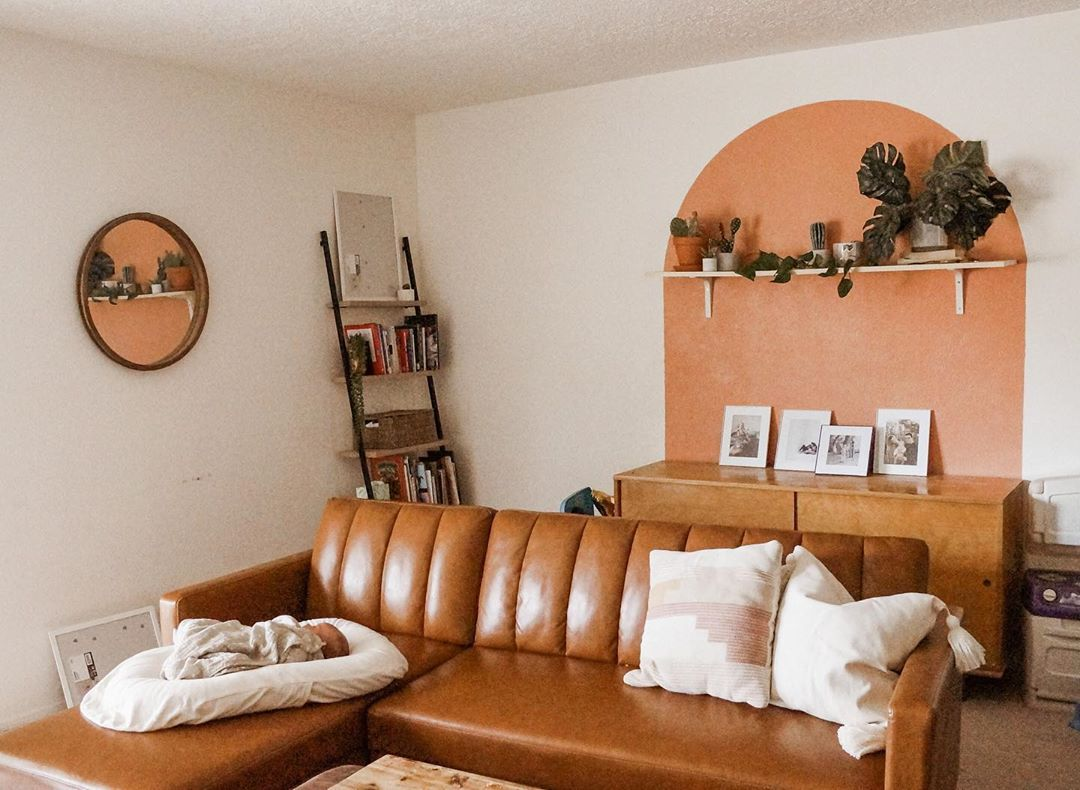 Living room with orange accent wall
