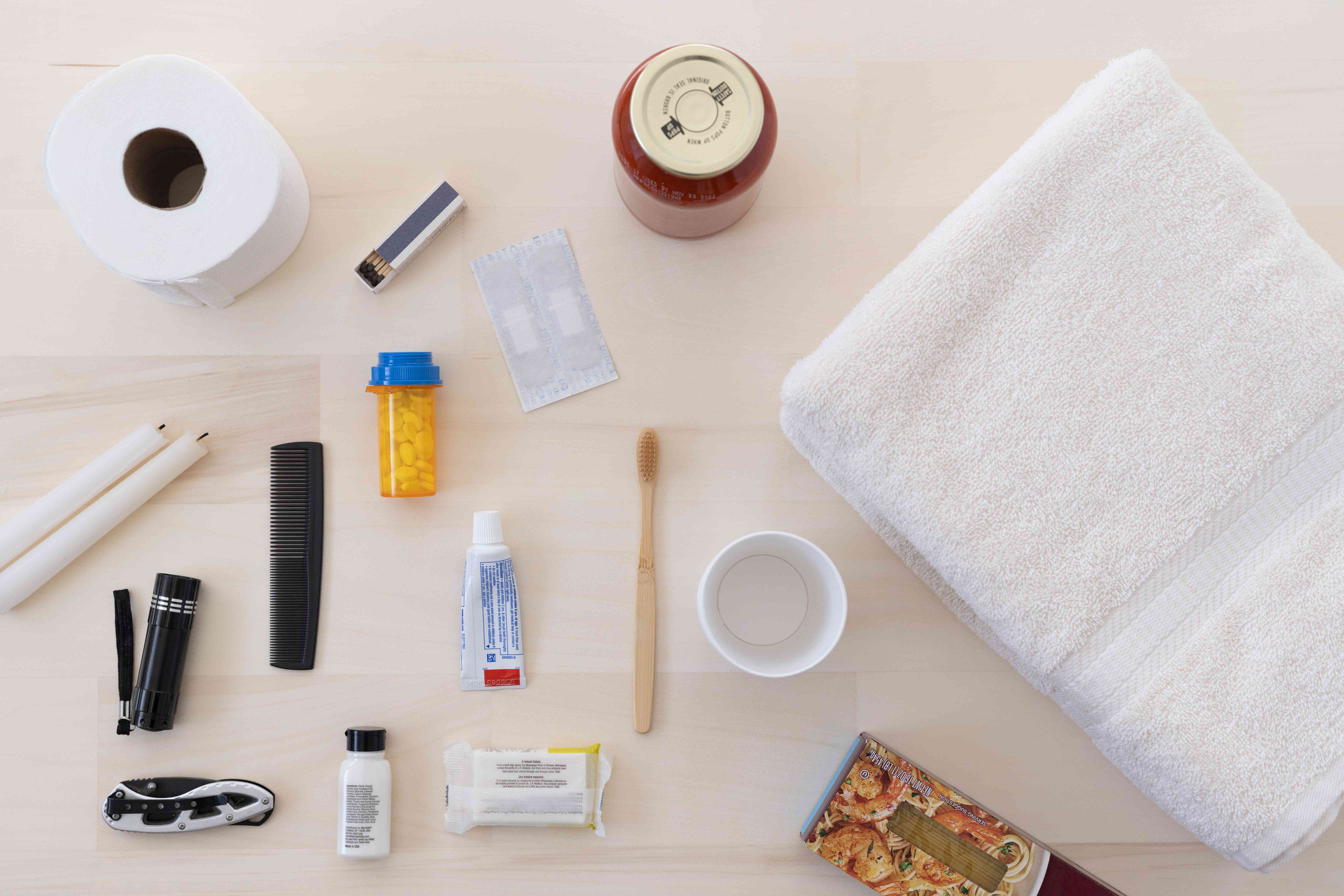 Small household and toiletry items laid to be packed in essentials box
