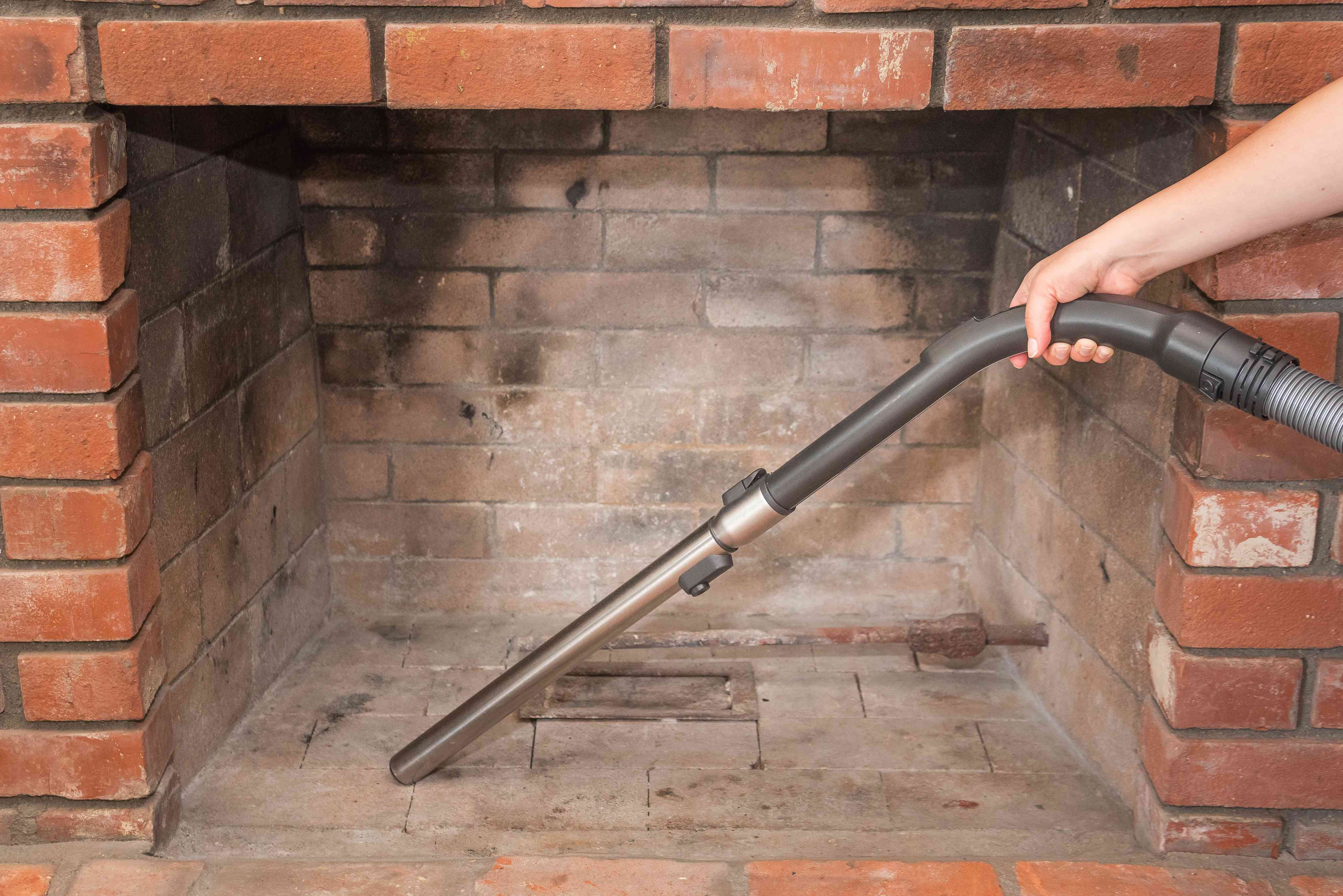 Fireplace soot and dirt vacuumed with long handle