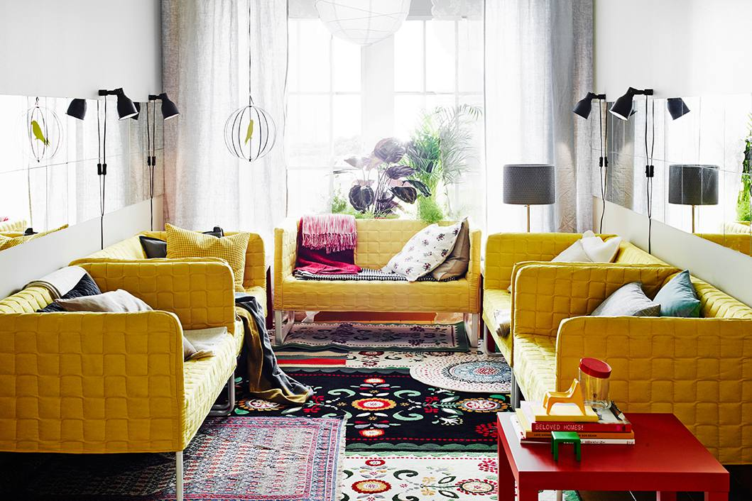 Several rugs placed underneath yellow couches