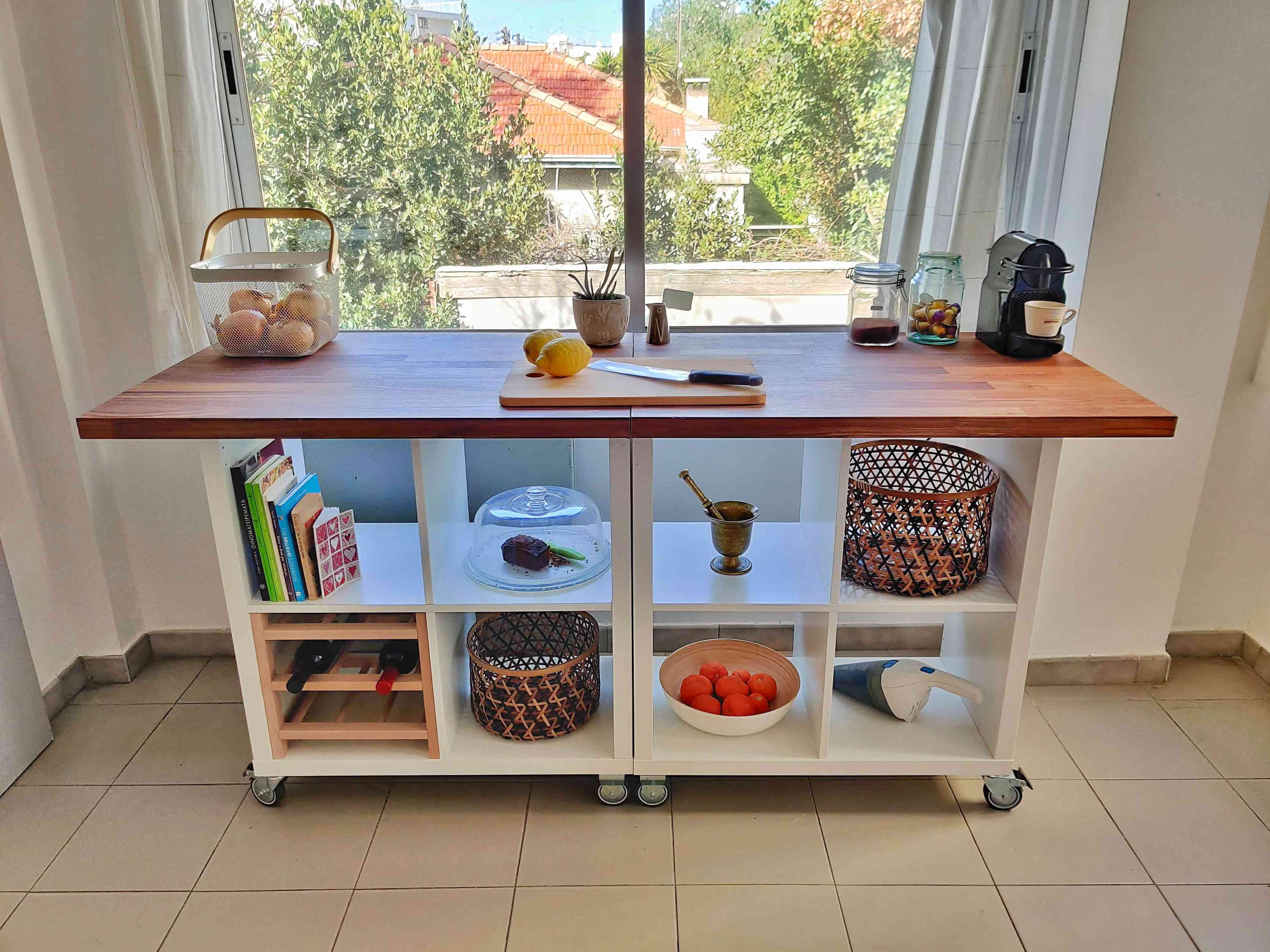 White and wooden kitchen island on wheels