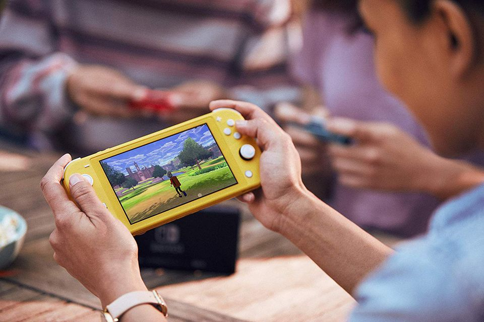Yellow Nintendo Switch being played.